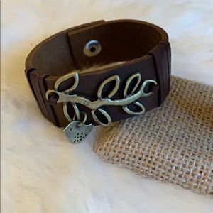 Leather bracelet with bird on branch